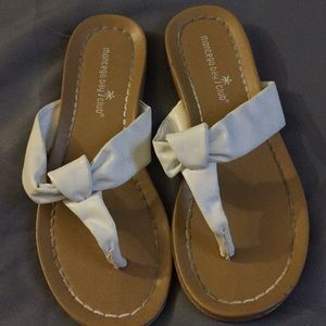 Montego Bay Club White faux leather flip flops.